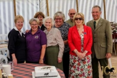Society-officials-cutting-the-official-centenary-cake